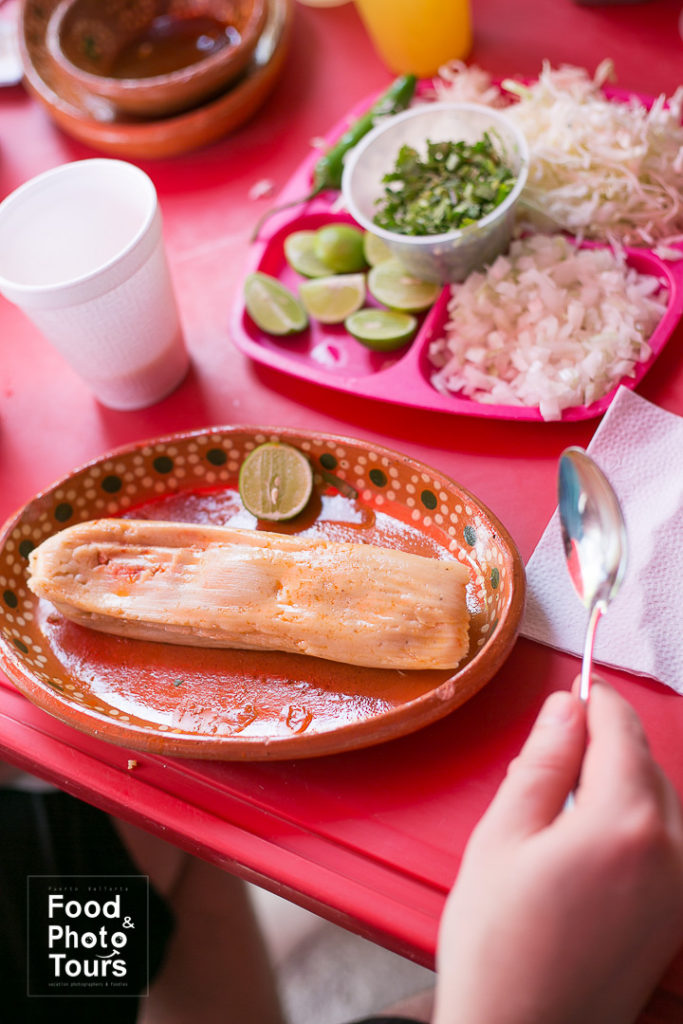 Tamales. A Millenials couple taking a Food Tour in Puerto Vallarta at a working class neighborhood called Pitillal.