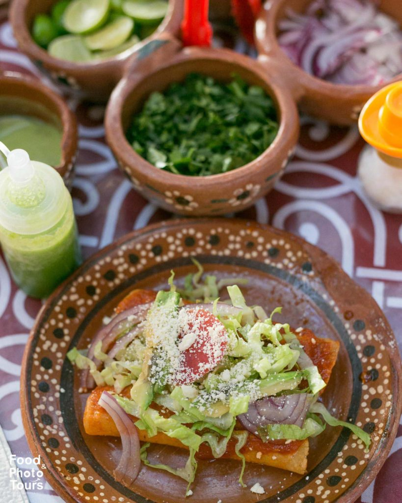Mexican comfort food in Pitillal. enchiladas de Birria. Food Tour in Pitillal by Food and Photo Tours.