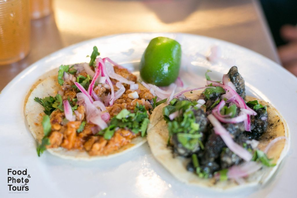 Cochinita Pibil Taco and a Pok Chuc Taco_a_photo_taken_on_a_food_tour_in_Pitillal_Puerto_Vallarta