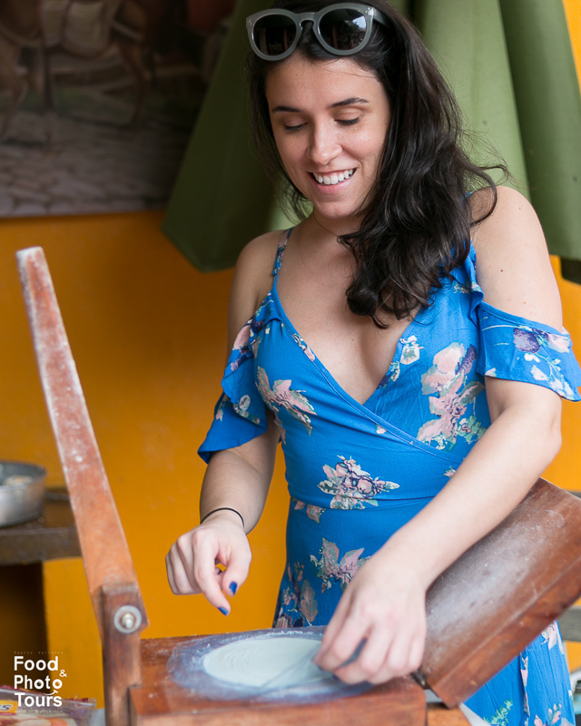 A tourist / traveler making tortillas during a Food Tour in Puerto Vallarta.