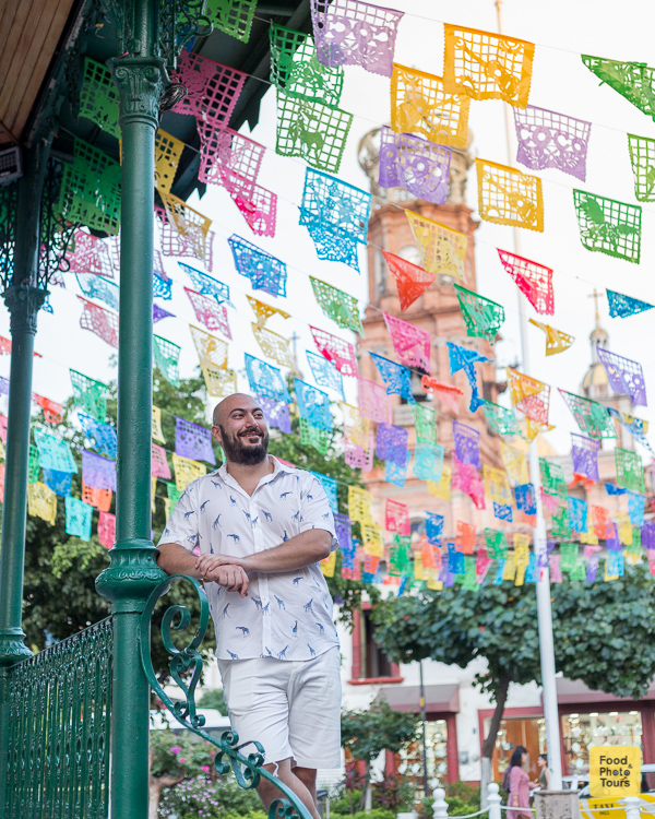 American millenial male solo traveler in a photo shoot in Puerto Vallarta Downtown